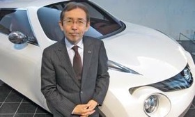 Nissan global design chief Shiro Nakamura with the new Juke small crossover. Besides better aerodynamics and less wind noise, disconnecting the front and rear lamps from the contour of the car body &#8220;gives us more design freedom,&#8221; he says. (Photo by Hans Greimel.)