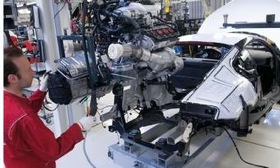 A technician marries the engine to the body in Audi's R8 assembly plant in Germany. Get an inside look at the plant on the National Geographic Channel on Monday night.