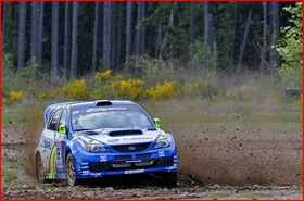 Travis Pastrana -- and guest -- taking a corner. (Photo courtesy of Subaru Rally Team.)