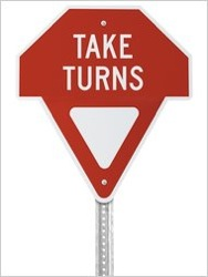 Gary Lauder's Take Turns sign. (Photo from the New York Times Wheels blog.)