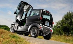 The single door on Gordon Murray's T25 city car pivots forward. (Photo from AutoWeek.)