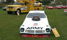 Don Prudhomme's Army sponsored Vega funny car was one of the cars he had on display. In back is the famous Hot Wheels Dodge transporter and funny car. (Photo by Patrick C. Paternie.)