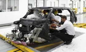 BMW will cut the weight of the MegaCity Vehicle by making its structure from carbon fiber. Here a prototype undergoes airbag testing. (Photo courtesy of AutoWeek.)
