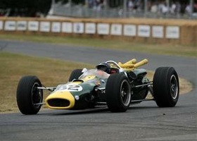 Jackie Stewart is shown at the wheel of a Lotus race car at Goodwood. (Photo by LAT Photographic.)
