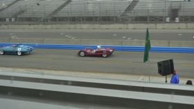 Historic race cars tearing around the Laguna Seca racetrack. (Photo by Josh Condon.)