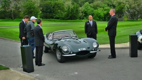 Jaguar execs gather around an XKSS. (Photo by Josh Condon.)