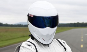 The masked racer known as the Stig, from BBC's Top Gear. (Photo by Todd Antony/BBC, from Guardian UK.)