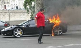 This photo of a Ferrari 458 Italia owner walking away from his burning car in Paris has been posted on several Internet sites. (Photo courtesy of AutoWeek.)