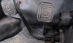 The pedal set on a classic Volkswagen Beetle was hinged on the car's floorboard. Floor-hinged pedals are in tune with the natural motion of your foot. (Photo from AutoWeek.)