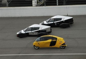 Two of Edison2's Very Light Cars (in silver and black) and one of the X-Tracer vehicles (in yellow) take to the track at the Michigan International Speedway during the finals of the Progressive Automotive Insurance X Prize. Edison2's Very Light Car No. 98, the car in the lead, won the top prize of $5 million, and the X-Tracer team won $2.5 million. (From MSNBC.)