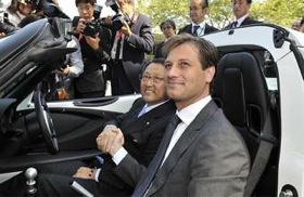 Lotus CEO Dany Bahar (right) presents an Elise to Toyota president Akio Toyoda. (Photo courtesy of Lotus.)