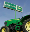 John Deere equipment stands ready for sale at Deems Farm Equipment Inc., in Lawrence, KA (© Orlin Wagner/AP)