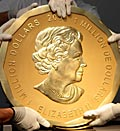Caption: Experts handle the world's largest gold coin after auction in Vienna. Credit: (© Heinz-Peter Bader/Reuters)