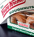 Credit:  Mark Lennihan/AP&#10;Caption: Box of Krispy Kreme doughnuts