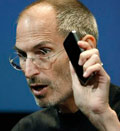 Apple CEO Steve Jobs holds up iPhone 4 as he talks about the Apple iPhone 4 at Apple headquarters in Cupertino, Calif., Friday, July 16, 2010  (© Paul Sakuma/AP)
