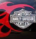 Credit: (© Stephan Savoia/AP)Caption: Gas tank of Harley-Davidson motorcycle