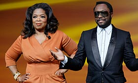 Rapper and producer will.i.am paid off delinquent home mortgages for two guests on 'The Oprah Winfrey Show.' (© Mary Altaffer/AP)