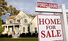 The number of households that received a foreclosure filing in April is down 2% from April 2009. (© Ariel Skelley/Getty Images)