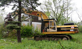 Detroit plans to demolish 6,000 abandoned homes in the next two years. (© Carlos Osorio/AP)