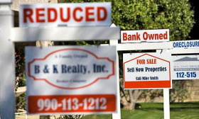 Foreclosure activity fell 3% in May despite banks seizing a record number of homes. (© moodboard/Corbis)